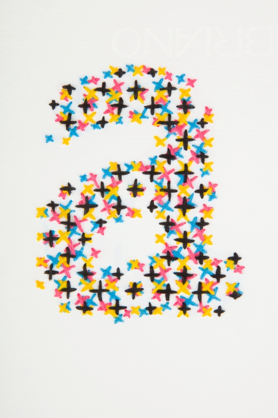 Handprinted alphabet in CMYK embroidery